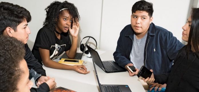 From left: Tyshawn Morgan, Chris Barrera, Najai McKenzie-Robinson, Randy Briones, and Isabella Barrera tackling a business problem in a humanities for entrepreneurs class at Austin's David Crockett High School. CREDIT: Jonno Rattman
